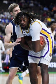 Mar 21, 2019; Jacksonville, FL, USA; LSU Tigers forward Naz Reid (0) grabs a rebound against Yale Bulldogs forward Blake Reynolds (32) during the first half in the first round of the 2019 NCAA Tournament at Jacksonville Veterans Memorial Arena. Mandatory Credit: John David Mercer-USA TODAY Sports