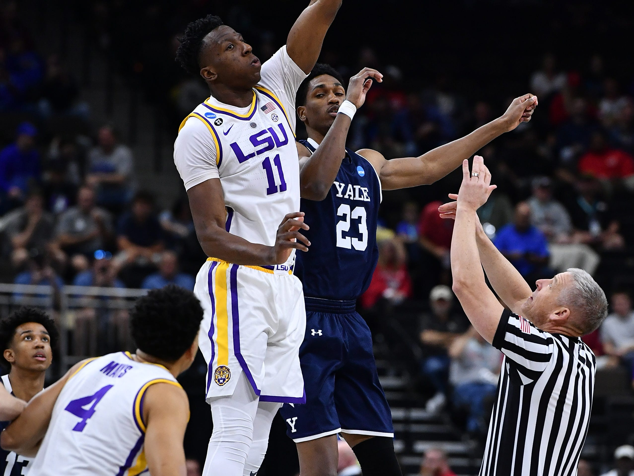 Mar 21, 2019; Jacksonville, FL, USA; LSU Tigers forward Kavell Bigby-Williams (11) wins the opening tip off against Yale Bulldogs forward Jordan Bruner (23) during the first half in the first round of the 2019 NCAA Tournament at Jacksonville Veterans Memorial Arena. Mandatory Credit: John David Mercer-USA TODAY Sports