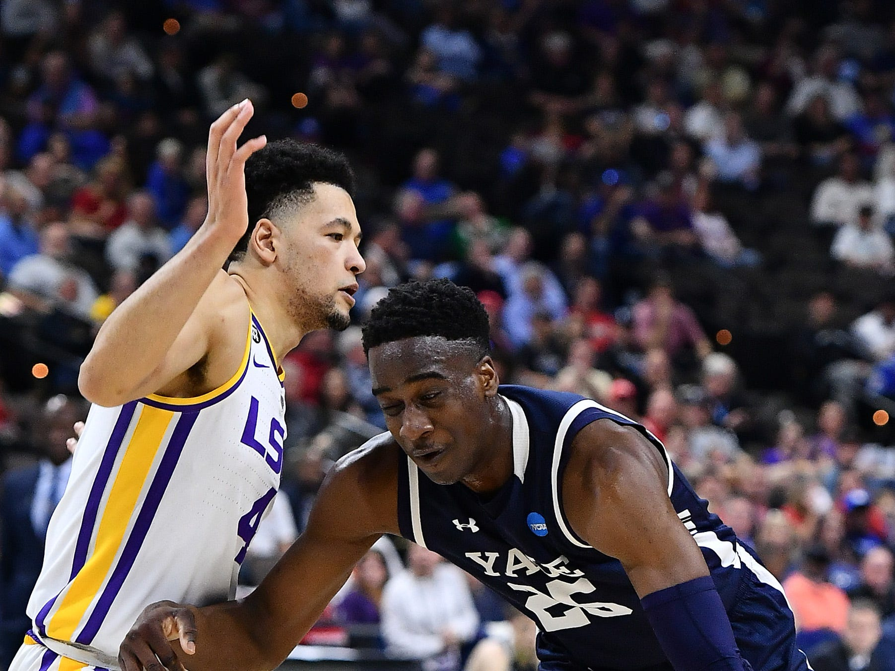 Mar 21, 2019; Jacksonville, FL, USA; Yale Bulldogs guard Miye Oni (25) drives against LSU Tigers guard Skylar Mays (4) during the first half in the first round of the 2019 NCAA Tournament at Jacksonville Veterans Memorial Arena. Mandatory Credit: John David Mercer-USA TODAY Sports