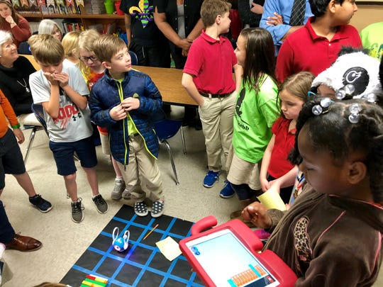 Fourth-graders in Woodvale Elementary's Robotics Club put their Dash and Dot Robots to the test and show their families what they've been working on for six weeks Tuesday, March 19.