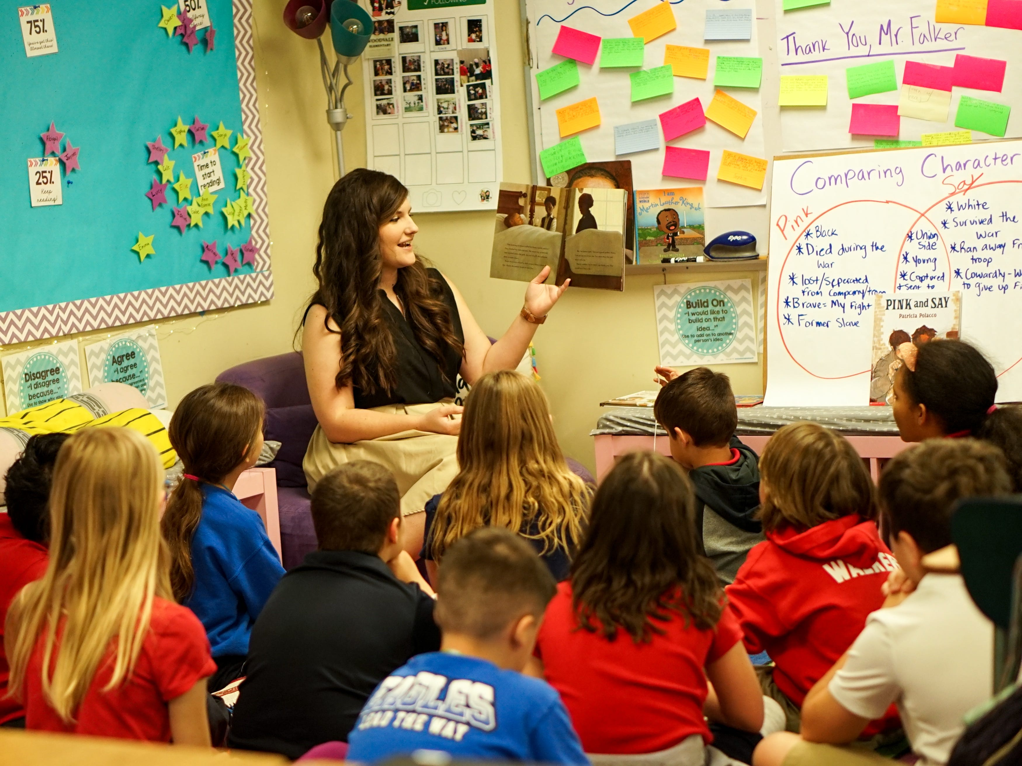 Twin sisters Taylor Wallace and Morgan Mercado share the same love for teaching at Woodvale Elementary School in Lafayette, Louisiana. Here, Mercado reads to her fourth-graders.