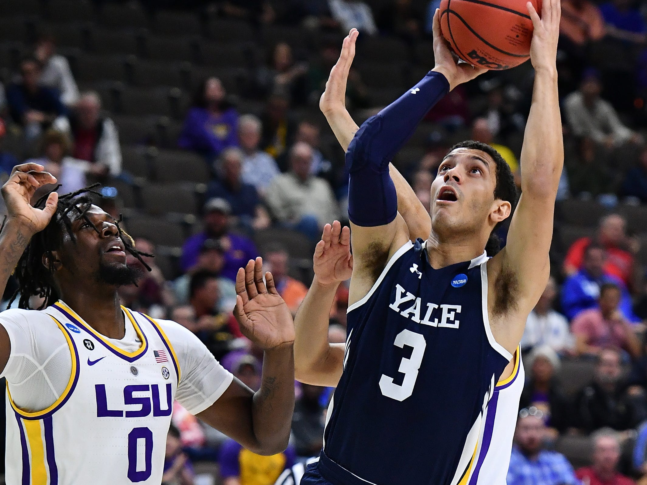 Mar 21, 2019; Jacksonville, FL, USA; Yale Bulldogs guard Alex Copeland (3) shoots against LSU Tigers forward Naz Reid (0) and guard Skylar Mays (behind Copeland) during the first half in the first round of the 2019 NCAA Tournament at Jacksonville Veterans Memorial Arena. Mandatory Credit: John David Mercer-USA TODAY Sports