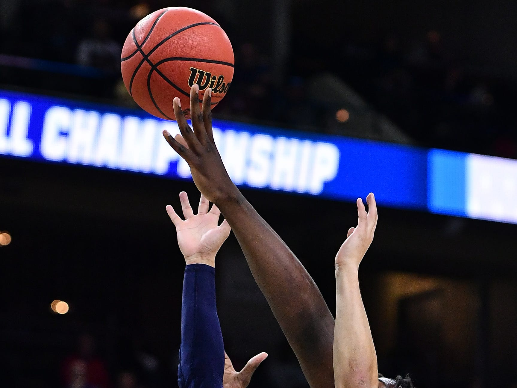 Mar 21, 2019; Jacksonville, FL, USA; Yale Bulldogs guard Alex Copeland (3) battles LSU Tigers forward Naz Reid (right) for a rebound during the first half in the first round of the 2019 NCAA Tournament at Jacksonville Veterans Memorial Arena. Mandatory Credit: John David Mercer-USA TODAY Sports