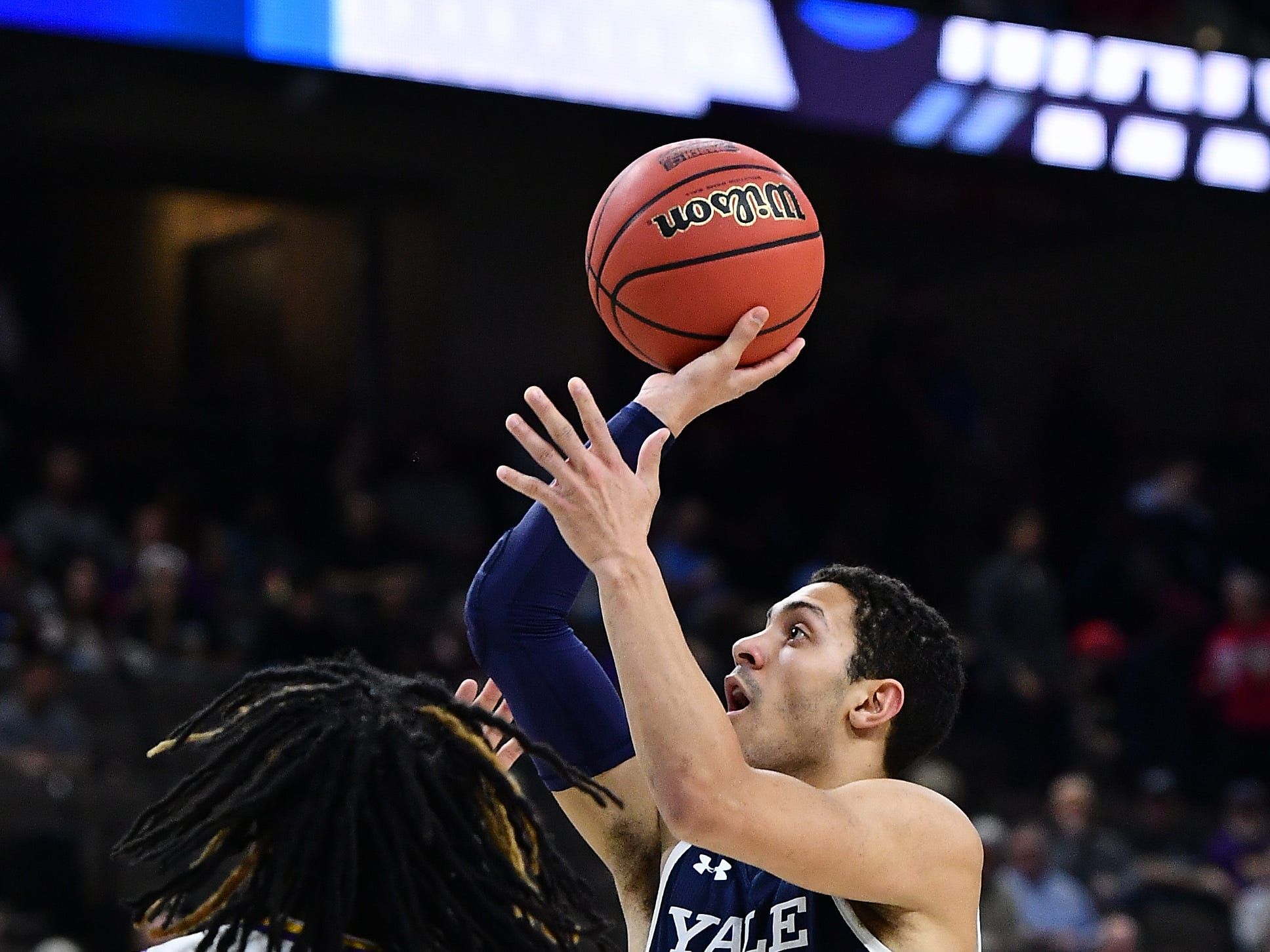 Mar 21, 2019; Jacksonville, FL, USA; Yale Bulldogs guard Alex Copeland (3) shoots against LSU Tigers forward Naz Reid (0) during the first half in the first round of the 2019 NCAA Tournament at Jacksonville Veterans Memorial Arena. Mandatory Credit: John David Mercer-USA TODAY Sports