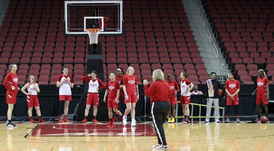 Louisville practices on March 21 at the KFC Yum Center the day before their game against Robert Morris.