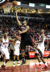 In this December 2010 photo, Cliff Dixon, No. 5, is seen during a Louisville-Western Kentucky game in Bowling Green. The former WKU player was killed in March 2019 in Georgia.