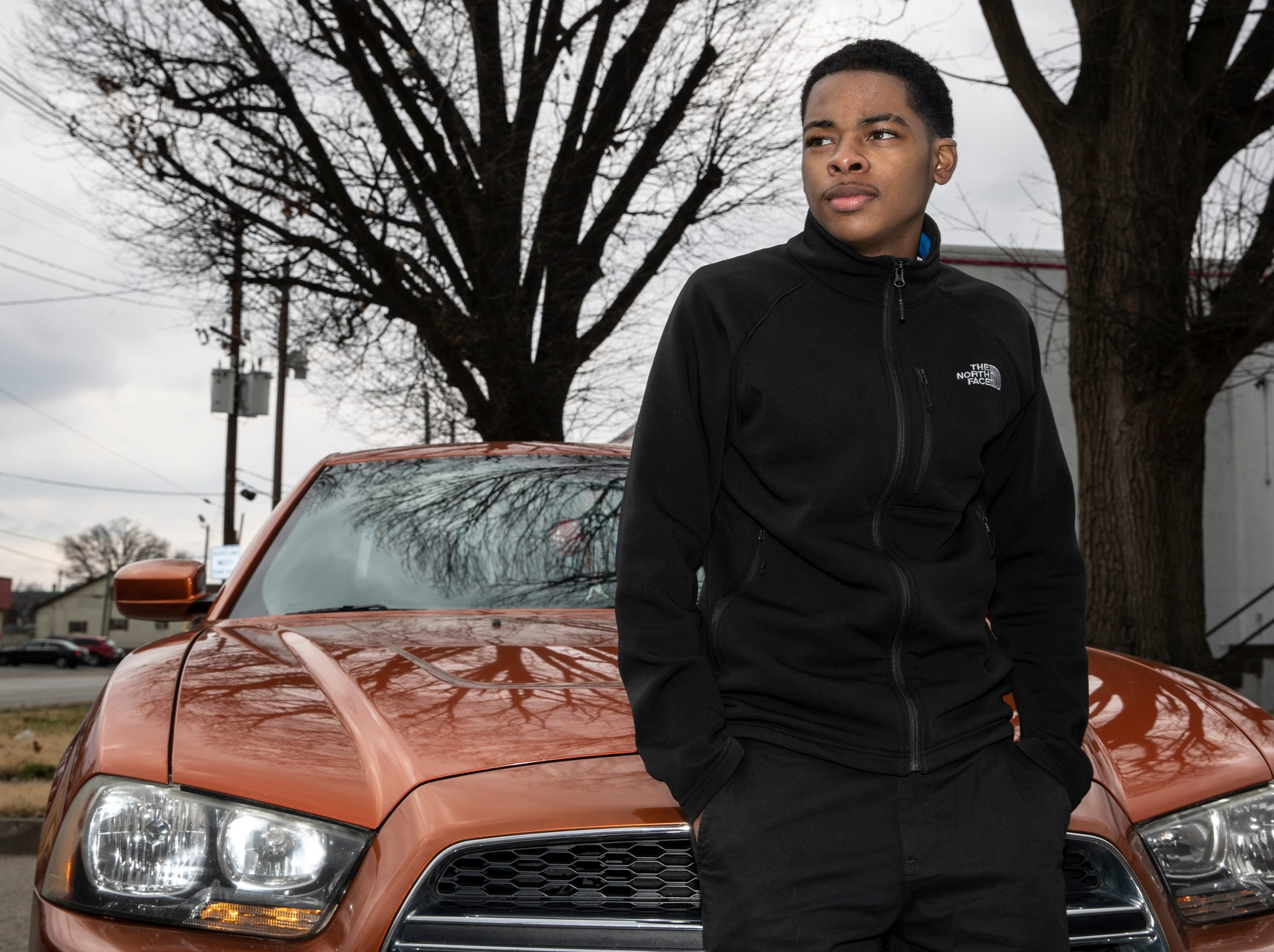 Tae-Ahn Lea, 18 was stopped by police, frisked and handcuffed at 18th and Burwell Ave. He is seen with the car he was driving. March 21, 2019.