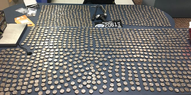 Lexington Police said Wednesday, March 20, 2019, they recovered more than $1,400 in stolen quarters from coin-operated air pumps at gas stations.