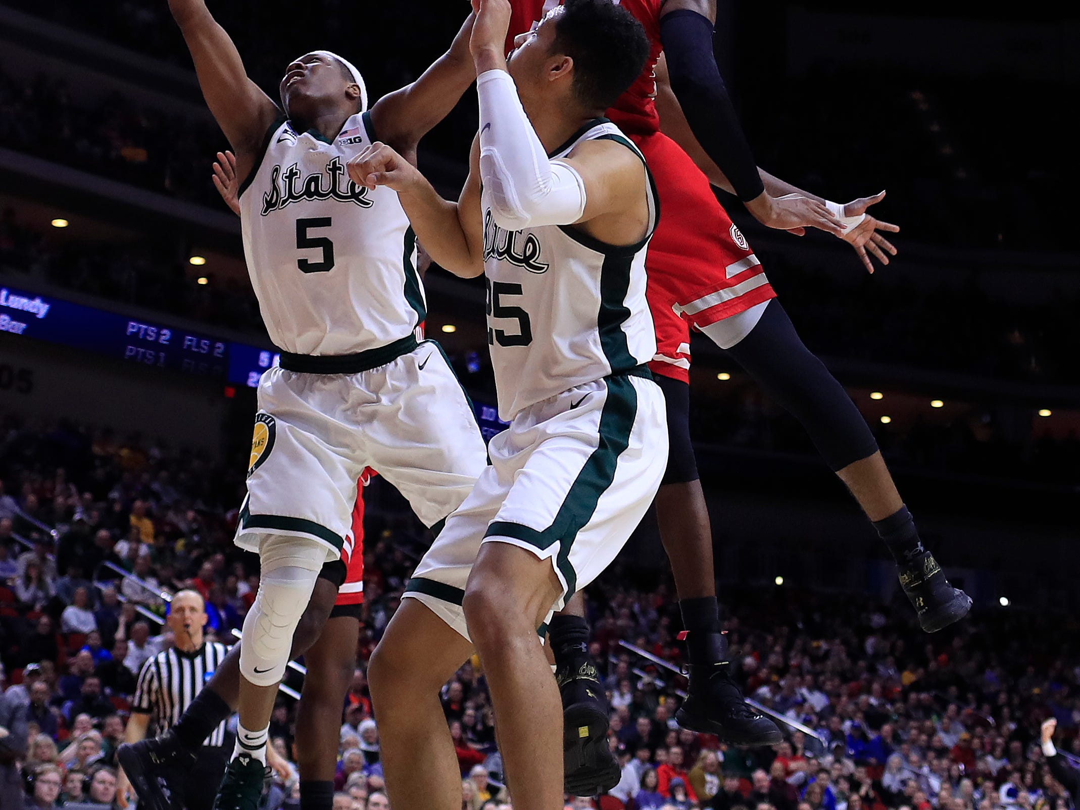 Elijah Childs #10 of the Bradley Braves defends a shot by Cassius Winston #5 of the Michigan State Spartans during their game in the First Round of the NCAA Basketball Tournament at Wells Fargo Arena on March 21, 2019 in Des Moines, Iowa.