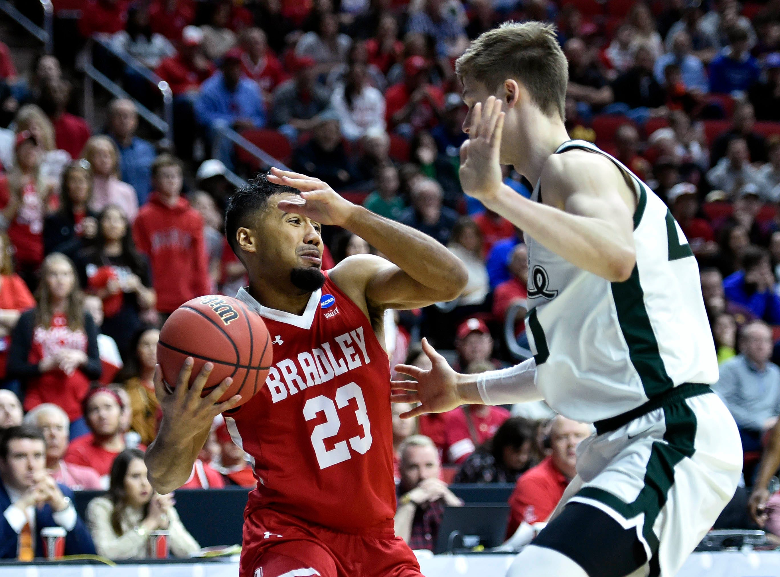 Bradley Braves guard Dwayne Lautier-Ogunleye (23) drives to the basket against Michigan State Spartans guard Matt McQuaid (20) during the second half in the first round of the 2019 NCAA Tournament at Wells Fargo Arena.