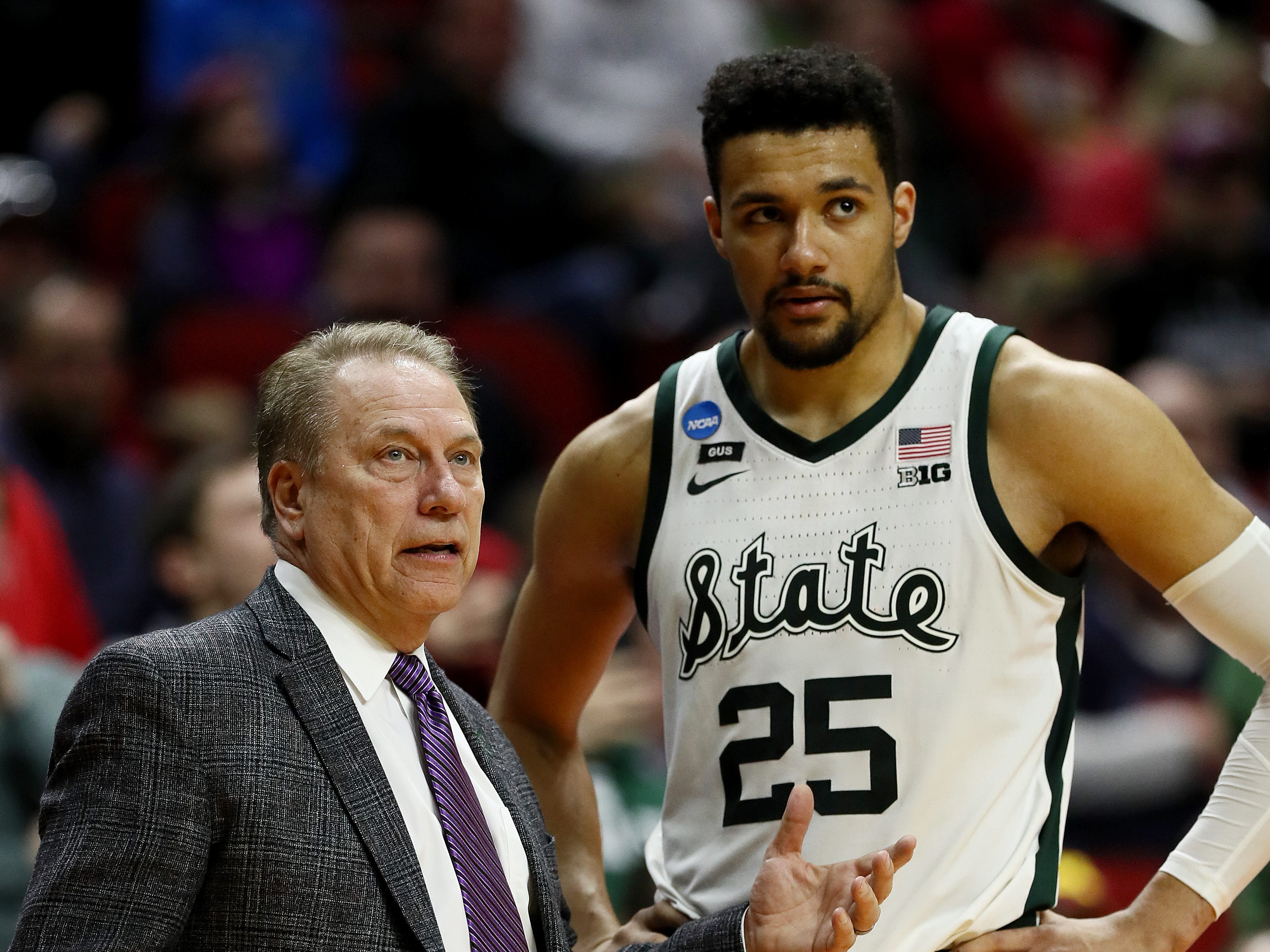 Head coach Tom Izzo of the Michigan State Spartans speaks with Kenny Goins #25 during their game in the First Round of the NCAA Basketball Tournament against the Bradley Braves at Wells Fargo Arena on March 21, 2019 in Des Moines, Iowa.