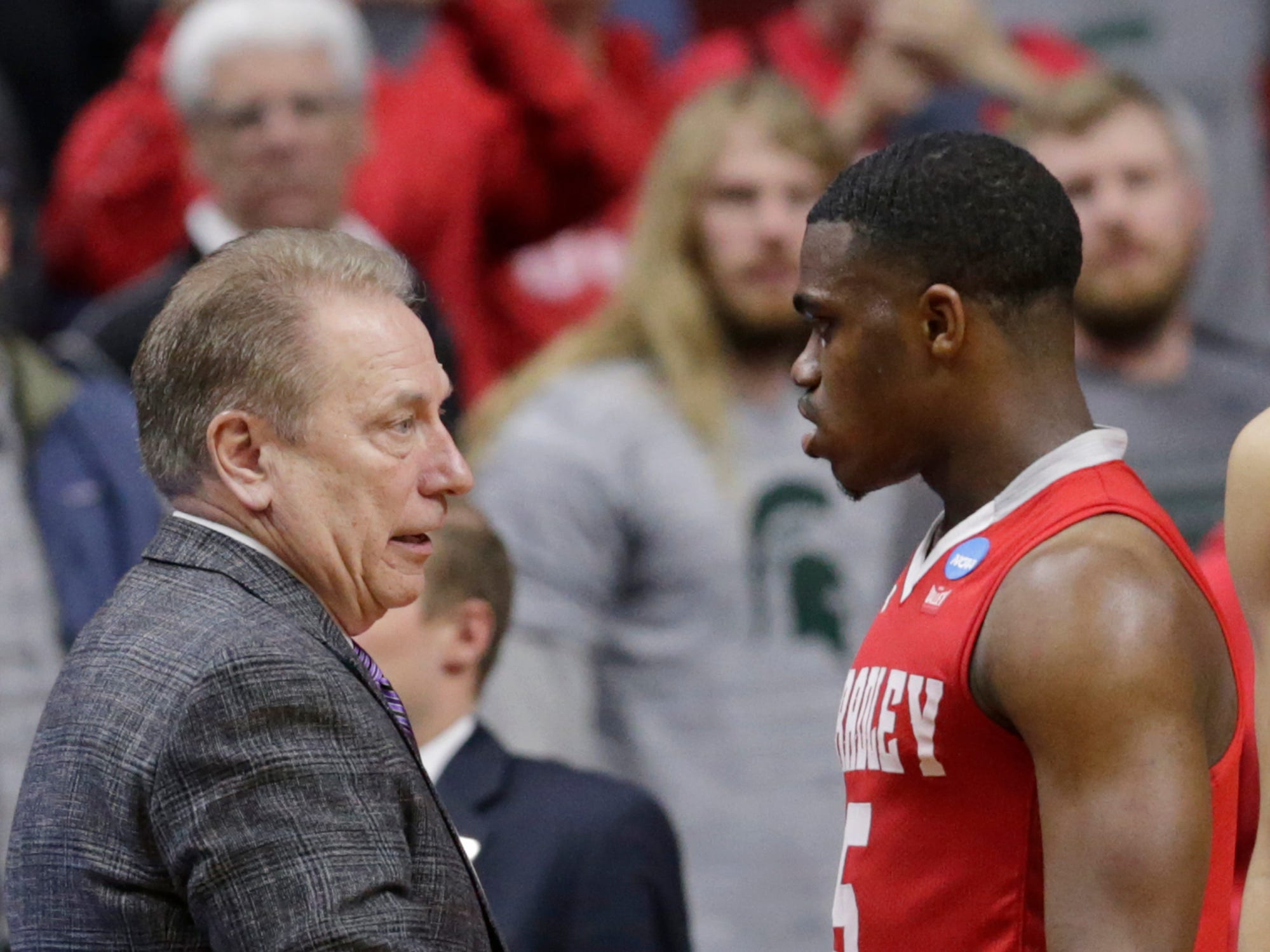 Michigan State coach Tom Izzo shakes the hand of Bradley's Darrell Brown (5) after a first round men's college basketball game in the NCAA Tournament, in Des Moines, Iowa, Thursday, March 21, 2019.
