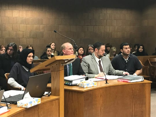 Bdour Al-Yasari (far left) and Jacob Ficher (far right) sit with their attorneys prior to their preliminary hearing March 21, 2019.