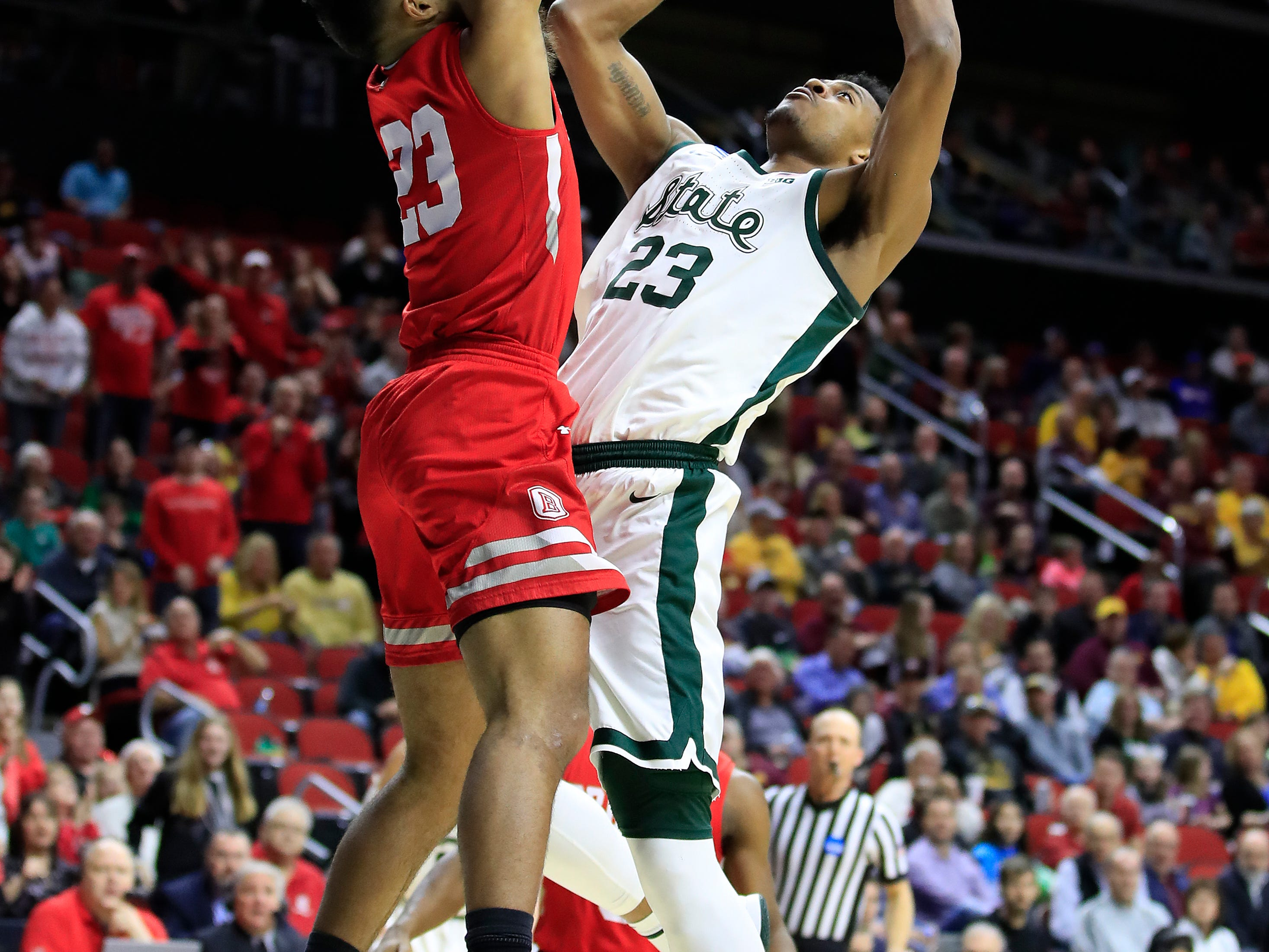Xavier Tillman #23 of the Michigan State Spartans goes up for a shot against the Bradley Braves during their game in the First Round of the NCAA Basketball Tournament at Wells Fargo Arena on March 21, 2019 in Des Moines, Iowa.