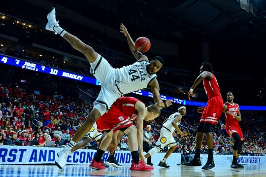 Nick Ward is undercut by Bradley's Nate Kennell during the Spartans' first-round NCAA tournament game.