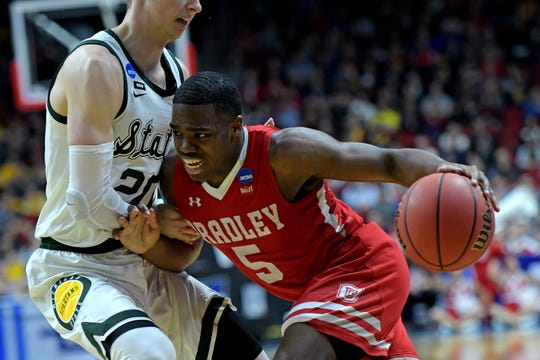 Bradley Braves guard Darrell Brown (5) drives to the basket against Michigan State Spartans guard Matt McQuaid (20) during the first half in the first round of the 2019 NCAA Tournament at Wells Fargo Arena.