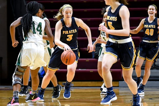 Pewamo-Westphalia's Hannah Spitzley, center, takes off on a fast break through Ypsilanti Arbor defenders during the first quarter on Thursday, March 21, 2019, at the Van Noord Arena on the Calvin College campus in Grand Rapids.