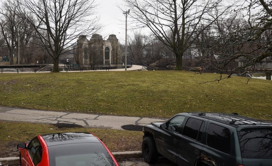 The Old Town Commercial Association is eying a grassy knoll near near the Brenke Fish Ladder as a possible site for community stage. The area, located along the Grand River in Lansing's Old Town neighborhood, is pictured on March 21, 2019.
