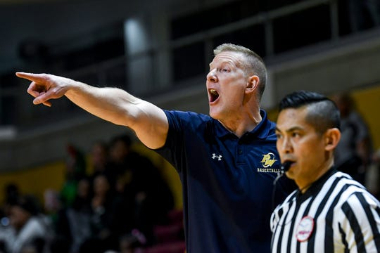 Pewamo-Westphalia's head coach Steve Eklund calls out to players during the fourth quarter on Thursday, March 21, 2019, at the Van Noord Arena on the Calvin College campus in Grand Rapids.