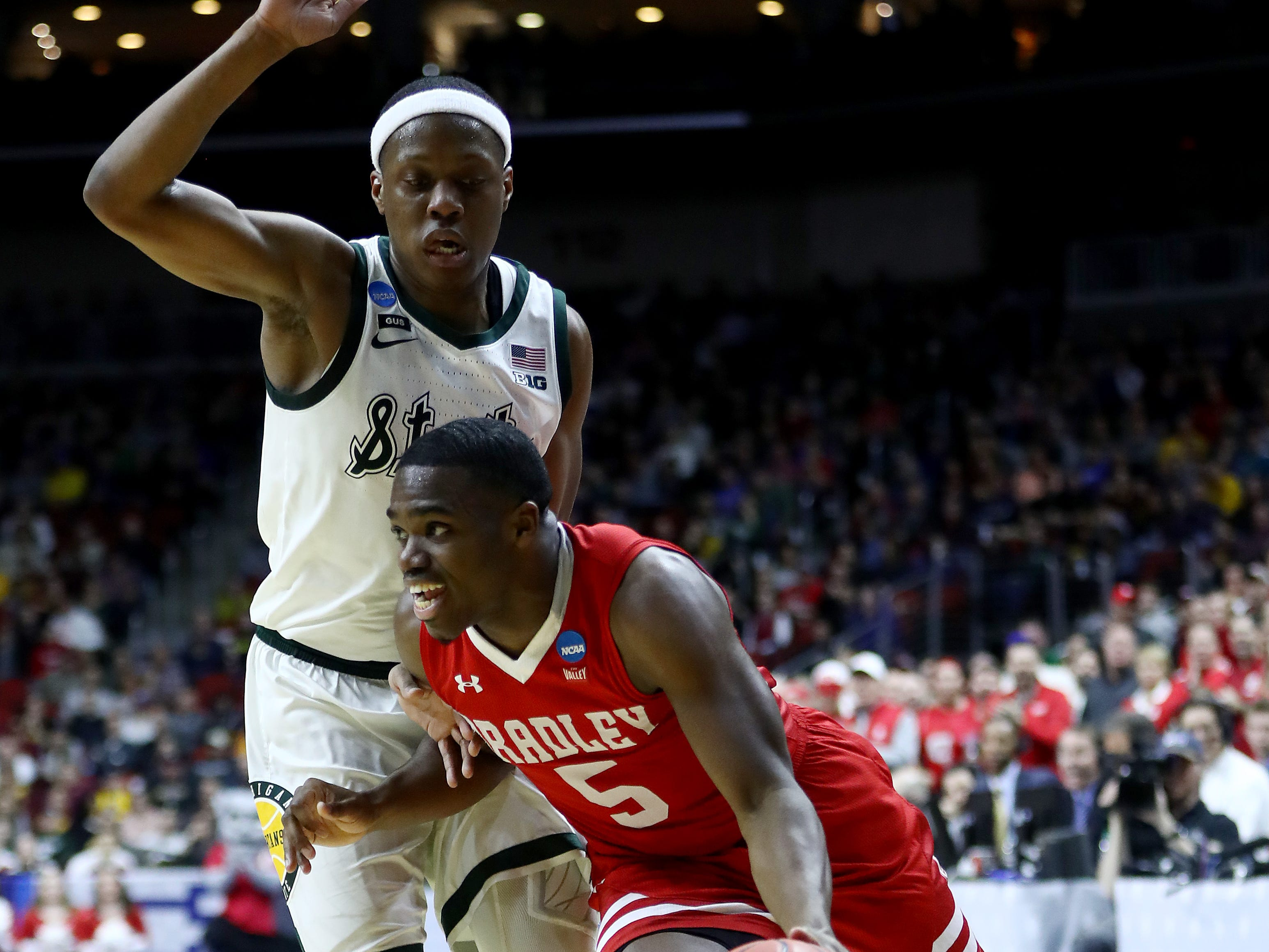 Darrell Brown #5 of the Bradley Braves drives with the ball against Cassius Winston #5 of the Michigan State Spartans during their game in the First Round of the NCAA Basketball Tournament at Wells Fargo Arena on March 21, 2019 in Des Moines, Iowa.