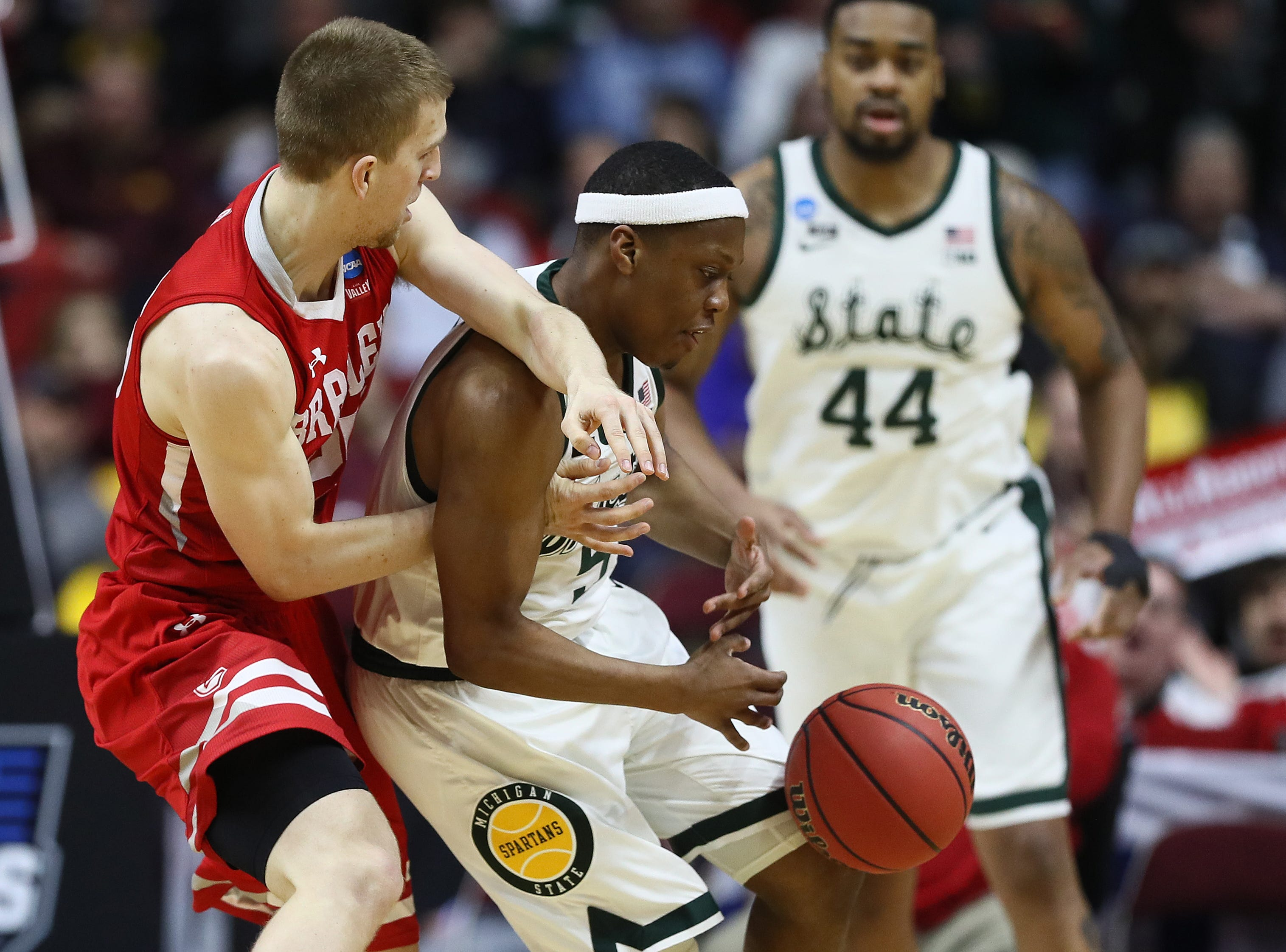Cassius Winston #5 of the Michigan State Spartans loses control of the ball against the Bradley Braves during their game in the First Round of the NCAA Basketball Tournament at Wells Fargo Arena on March 21, 2019 in Des Moines, Iowa.