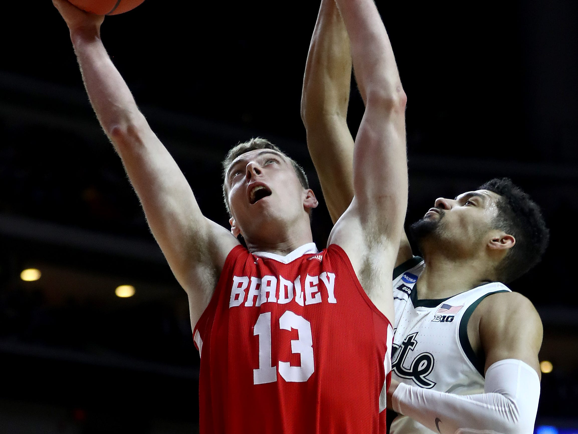 Luuk van Bree #13 of the Bradley Braves goes up for a shot against Kenny Goins #25 of the Michigan State Spartans during their game in the First Round of the NCAA Basketball Tournament at Wells Fargo Arena on March 21, 2019 in Des Moines, Iowa