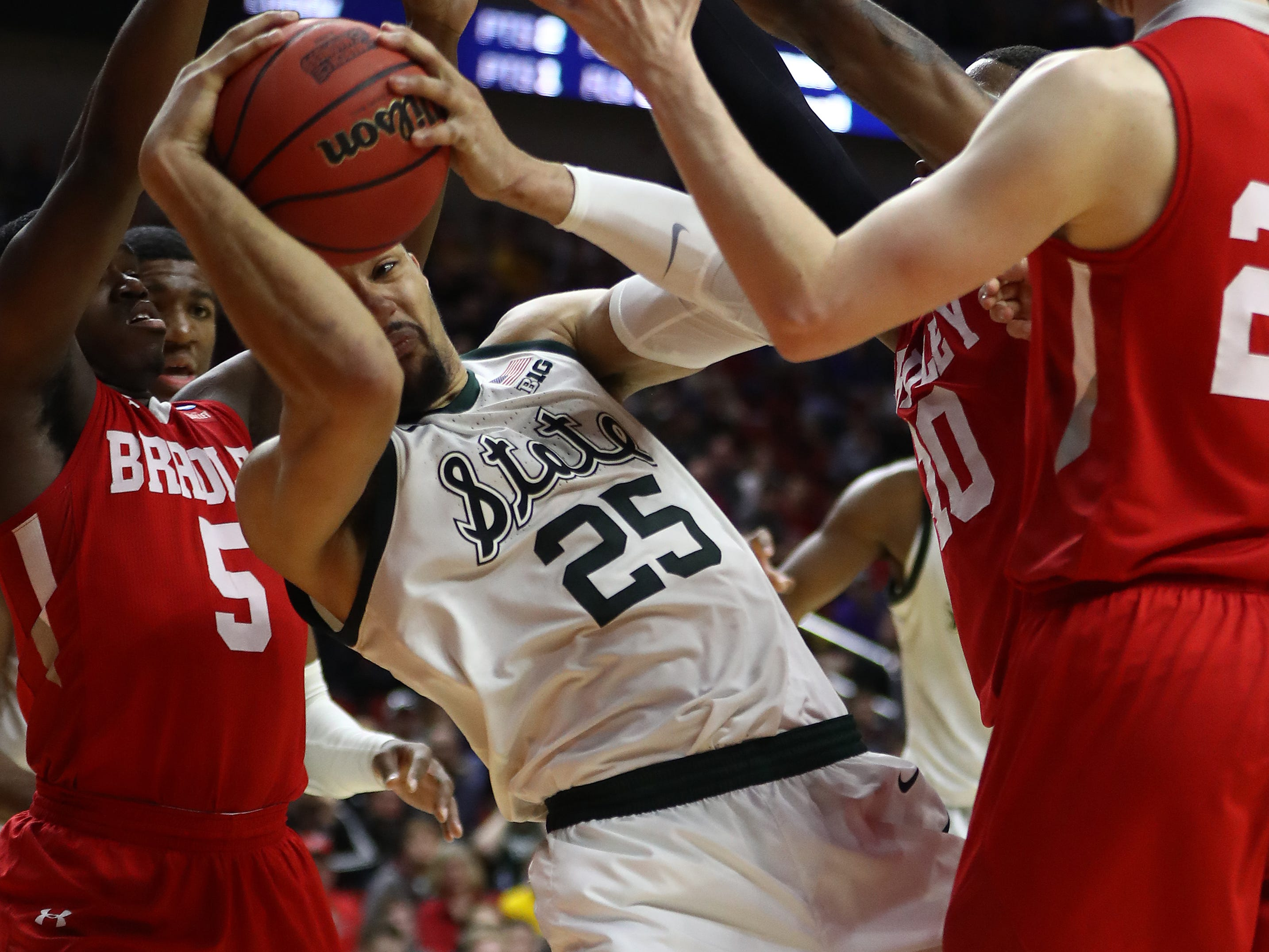 Kenny Goins #25 of the Michigan State Spartans controls the ball against the Bradley Braves during their game in the First Round of the NCAA Basketball Tournament at Wells Fargo Arena on March 21, 2019 in Des Moines, Iowa.