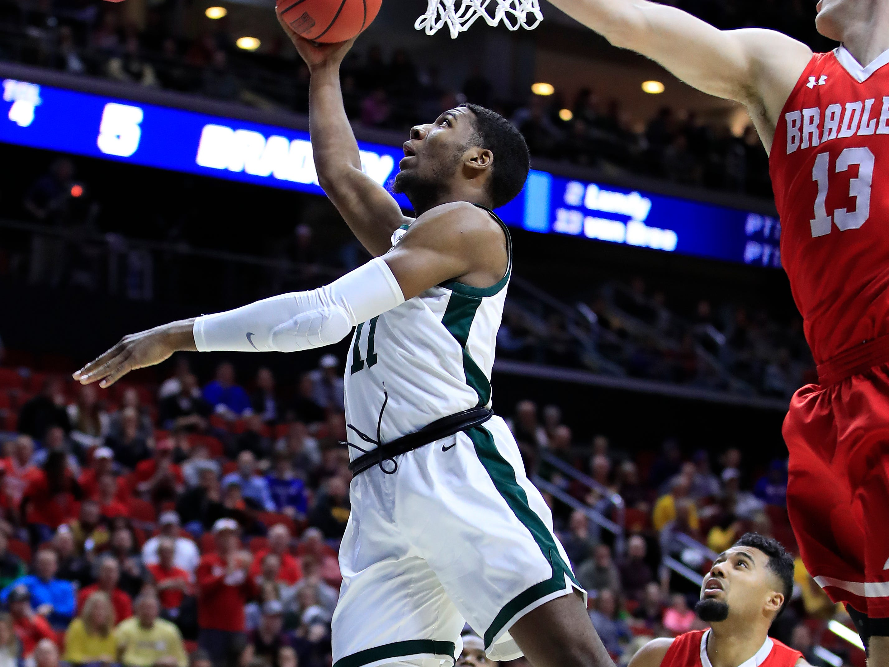 Aaron Henry #11 of the Michigan State Spartans goes up for a shot against the Bradley Braves during their game in the First Round of the NCAA Basketball Tournament at Wells Fargo Arena on March 21, 2019 in Des Moines, Iowa.