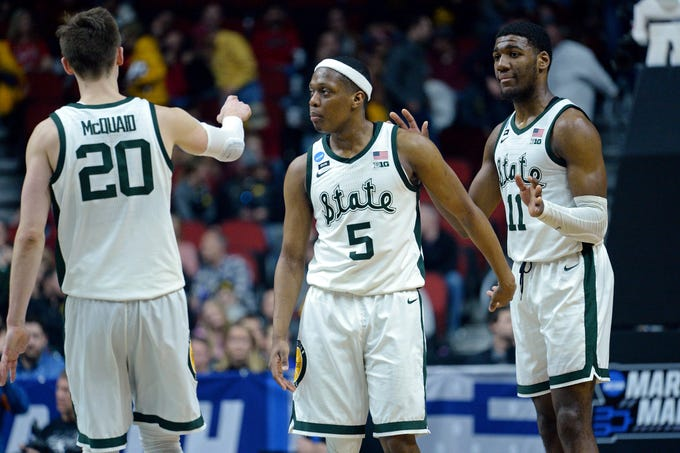 Michigan State Spartans guard Cassius Winston (5), guard Matt McQuaid (20) and forward Aaron Henry (11) react during the second half against the Bradley Braves in the first round of the 2019 NCAA Tournament at Wells Fargo Arena.