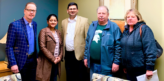 Mobil 310 Mart has new owners. Pictured from left: John Foster, Creative Business Services; Shobha Sharma and Busdev Adhikari of Sheboygan Oil and Marketing LLC; and Scott and Tammy Engstrom.