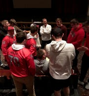New Manitowoc Lincoln football coach Greg Enz, middle, talks with his future players Sunday at the coaches welcome party.