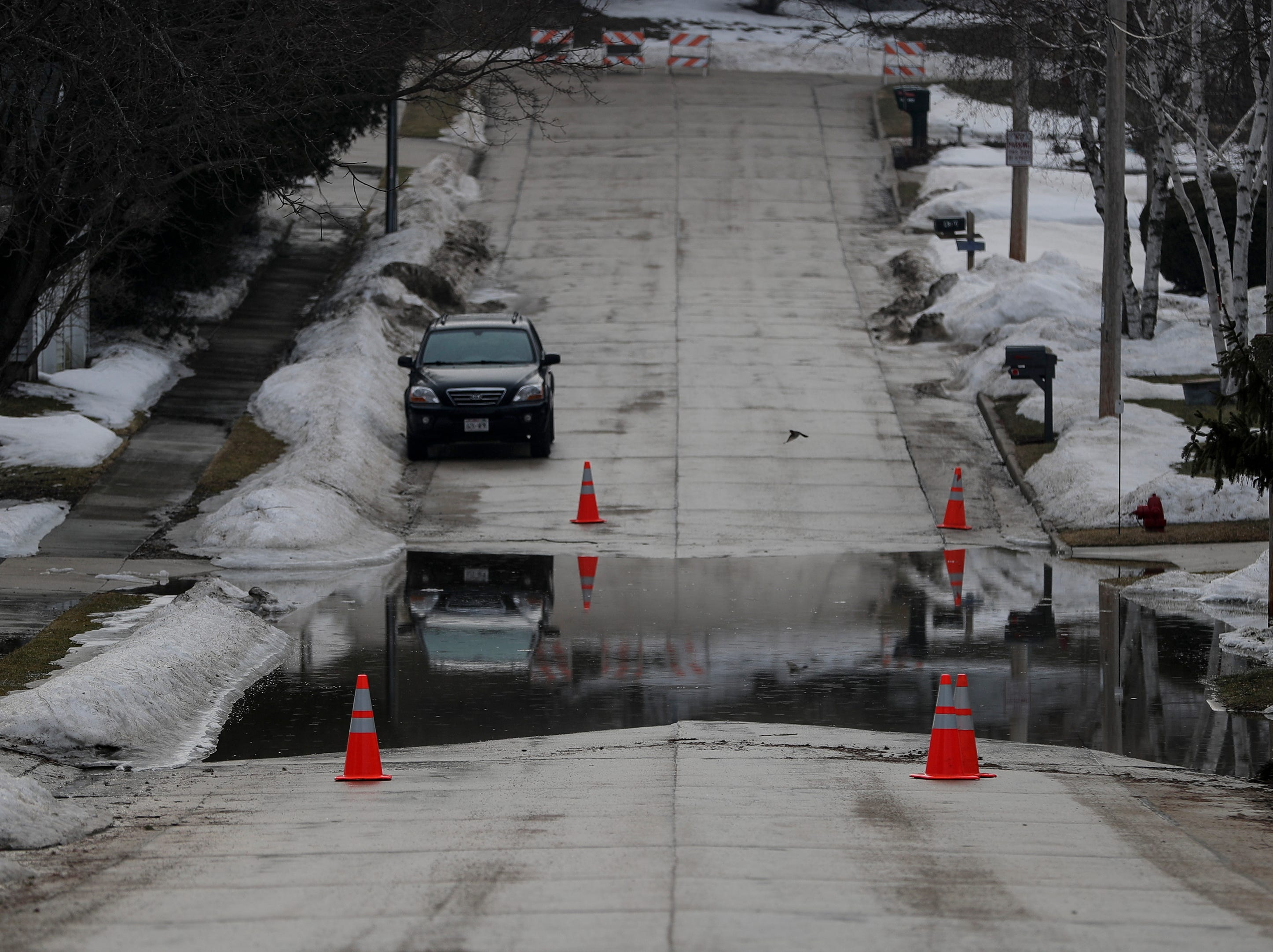 Water rises on the low part of Delta Street between Rapids Road and North 44th Street after ice jams up the Manitowoc River Wednesday, March 20, 2019, in Manitowoc, Wis. Joshua Clark/USA TODAY NETWORK-Wisconsin
