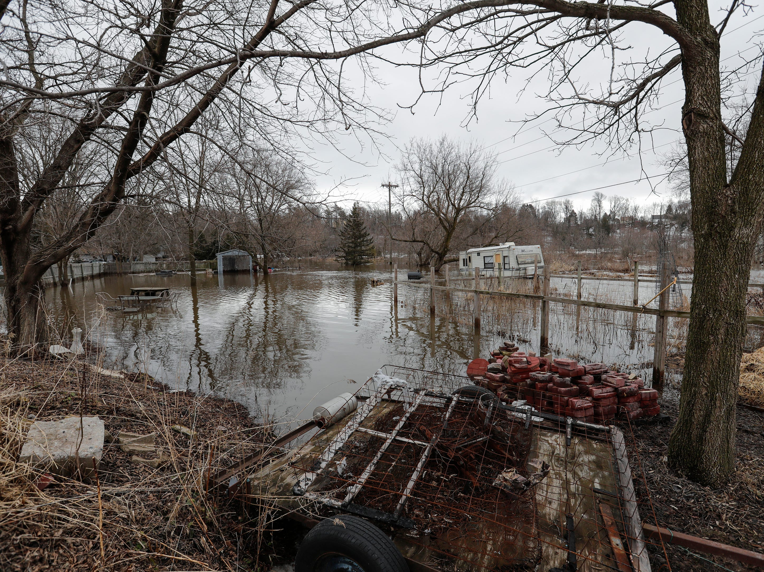 An ice jam on the Manitowoc River causes sever flooding on the block near 41st and Archer Thursday, March 21, 2019, in Manitowoc, Wis. Joshua Clark/USA TODAY NETWORK-Wisconsin