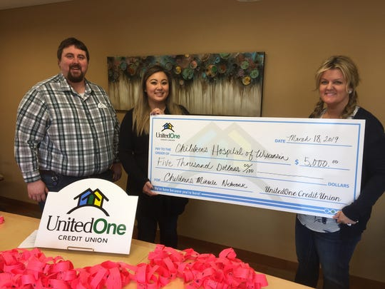 UnitedOne Credit Union is making a donation of $5,000 to Children's Hospital of Wisconsin. Pictured from left are Marketing Director Mike Farley, Member Service Representative Donna Vankham and Branch Manager Jayme Schwoerer.