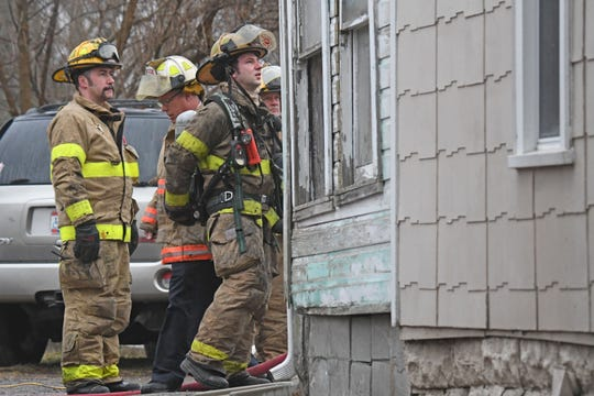 Firefighters rescued a woman from a house fire Thursday morning at 326 Harker Street.
