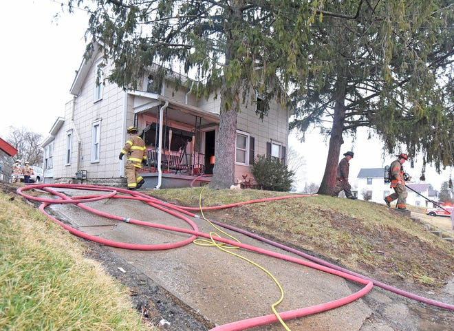 Mansfield firefighters rescued an occupant at 326 Harker Street on Thursday morning and extinguished a fire in the walls in the back of the residence.