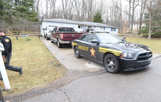 The Richland County Sheriff's Department and Ohio Bureau of Criminal Identification and Investigation collect evidence at the scene Thursday morning after a fatal shooting at 1665 Frontier Trail.