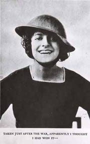 """This iconic 1918 photo of Elsie Janis, her curls bouncing out from under the brim of a steel Brody helmet, captures the essence of the WWI """"Sweetheart of the American Expeditionary Force."""""""
