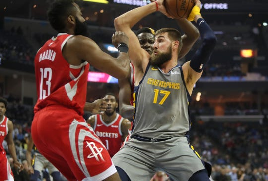 Memphis Grizzlies center Jonas Valanciunas cuts past   Houston Rockets guard James Harden to shoot the ball during their game at the FedExForum on Wednesday, March 20, 2019.