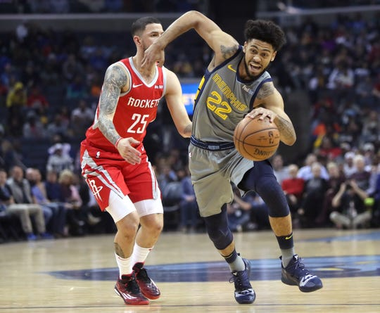 Memphis Grizzlies guard Tyler Dorsey drives past Houston Rockets guard Austin Rivers during their game at the FedExForum on Wednesday, March 20, 2019.