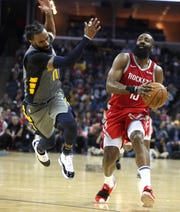 Memphis Grizzlies guard Mike Conley is called for a foul against Houston Rockets guard James Harden  during their game at the FedExForum on Wednesday, March 20, 2019.