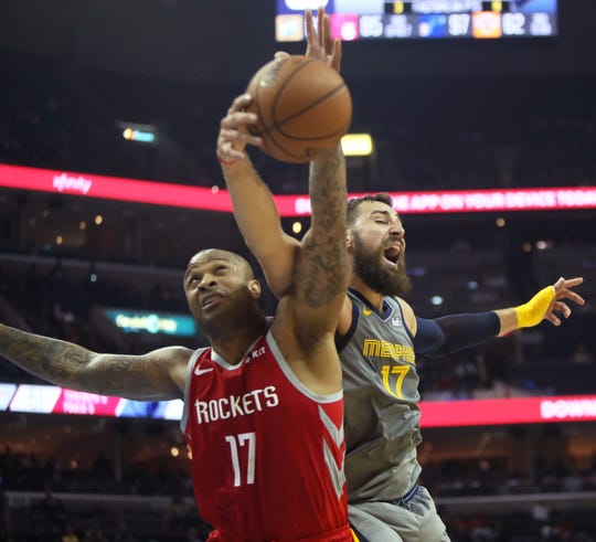 Grizzlies center Jonas Valanciunas battles Rockets forward PJ Tucker for a rebound during a game last season.