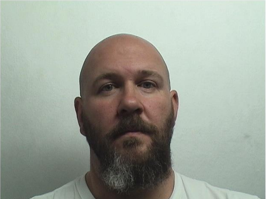 Dan Holcomb was arrested in connection with a domestic assault call.