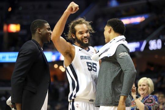 Memphis Grizzlies forward Joakim Noah celebrates with teammates Jaren Jackson, left and Ivan Rabb as they defeat the Utah Jazz at the FedExForum on Friday, March 8, 2019.