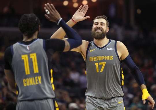 Grizzlies center Jonas Valanciunas high-fives Mike Conley during a win over the Rockets last week. The Grizzlies need to climb out of the NBA's bottom eight to convey a draft pick owed to the Celtics.