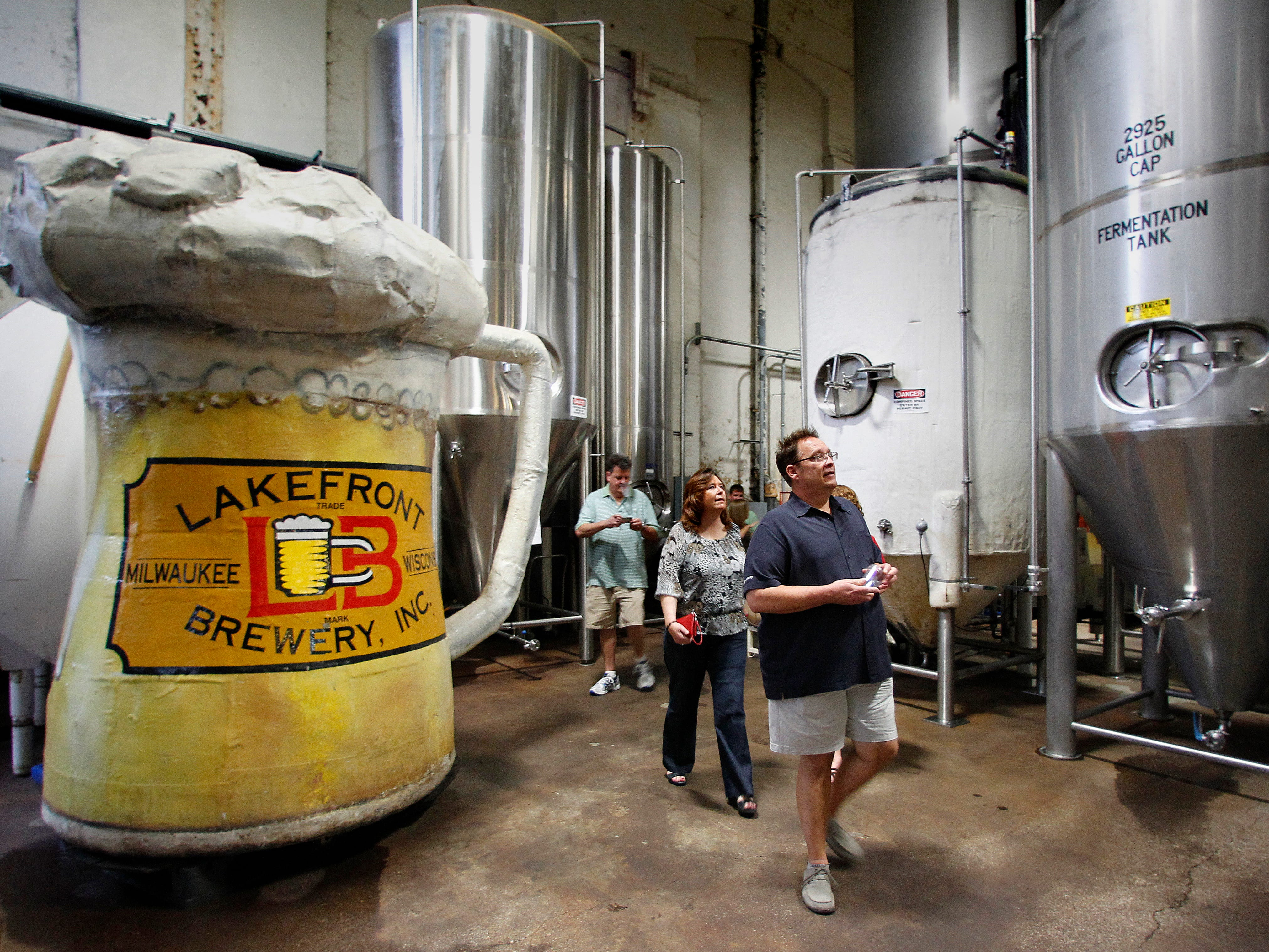People taking the tour at Milwaukee's Lakefront Brewery walk past the old beer mug from Bernie Brewer's chalet at County stadium on Sept. 7, 2012. The beer mug and Bernie's chalet are part of the Lakefront tour, which is one of the country's most popular brewery tours.
