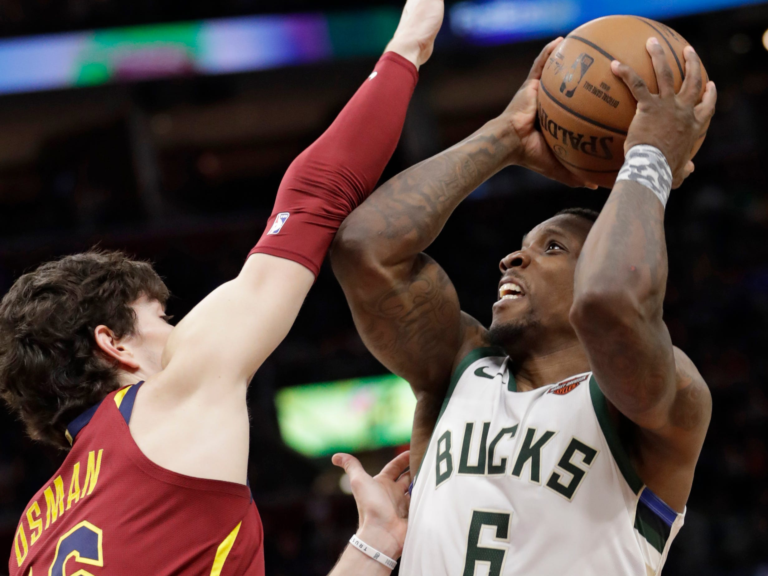 Bucks guard Eric Bledsoe goes up for a shot down low against the Cavaliers' Cedi Osman during the first half.