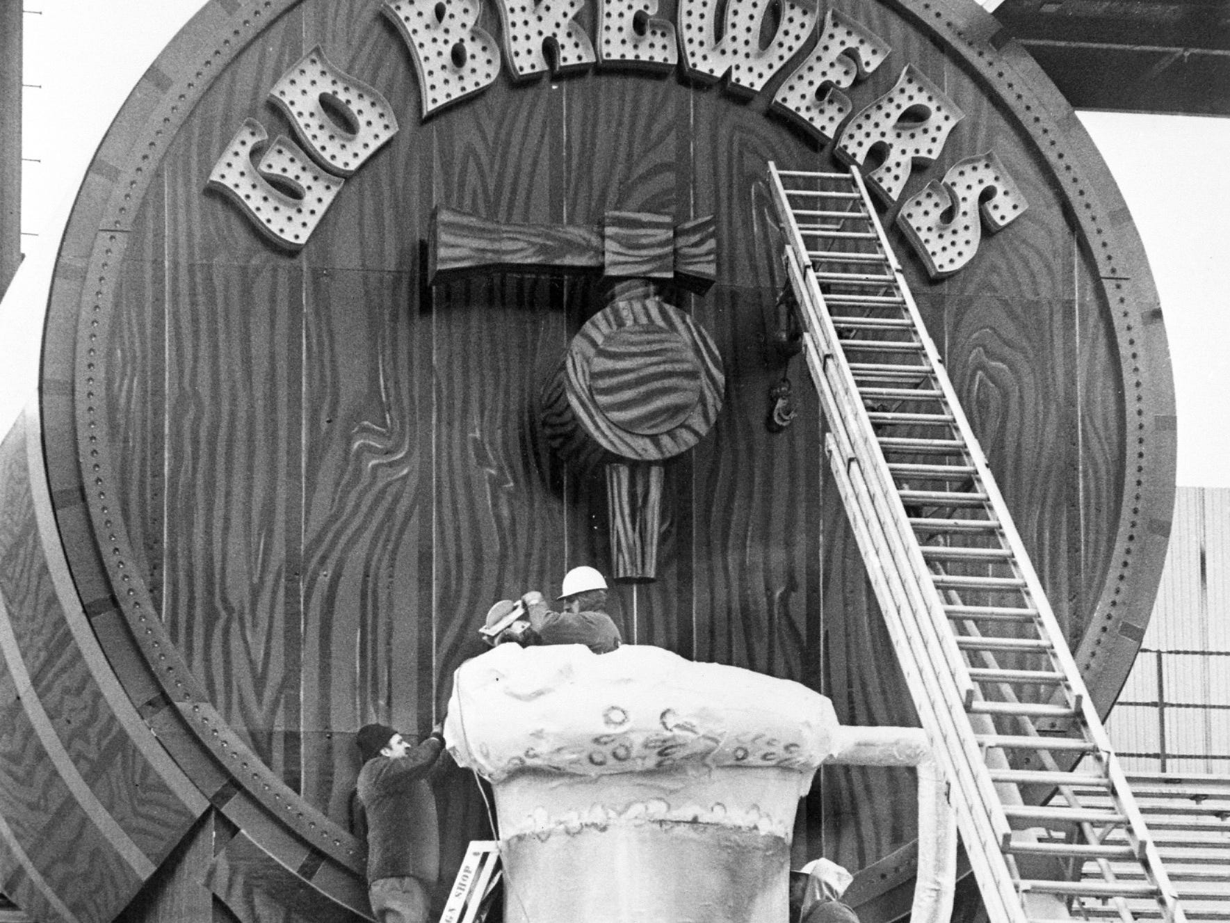 Workers set up the giant beer barrel and mug in the bleachers at County Stadium. At the upper right will be Bernie Brewer's new home, a Bavarian-style chalet, with a slide leading to the beer mug. This photo was published in the April 8, 1973, Milwaukee Journal.