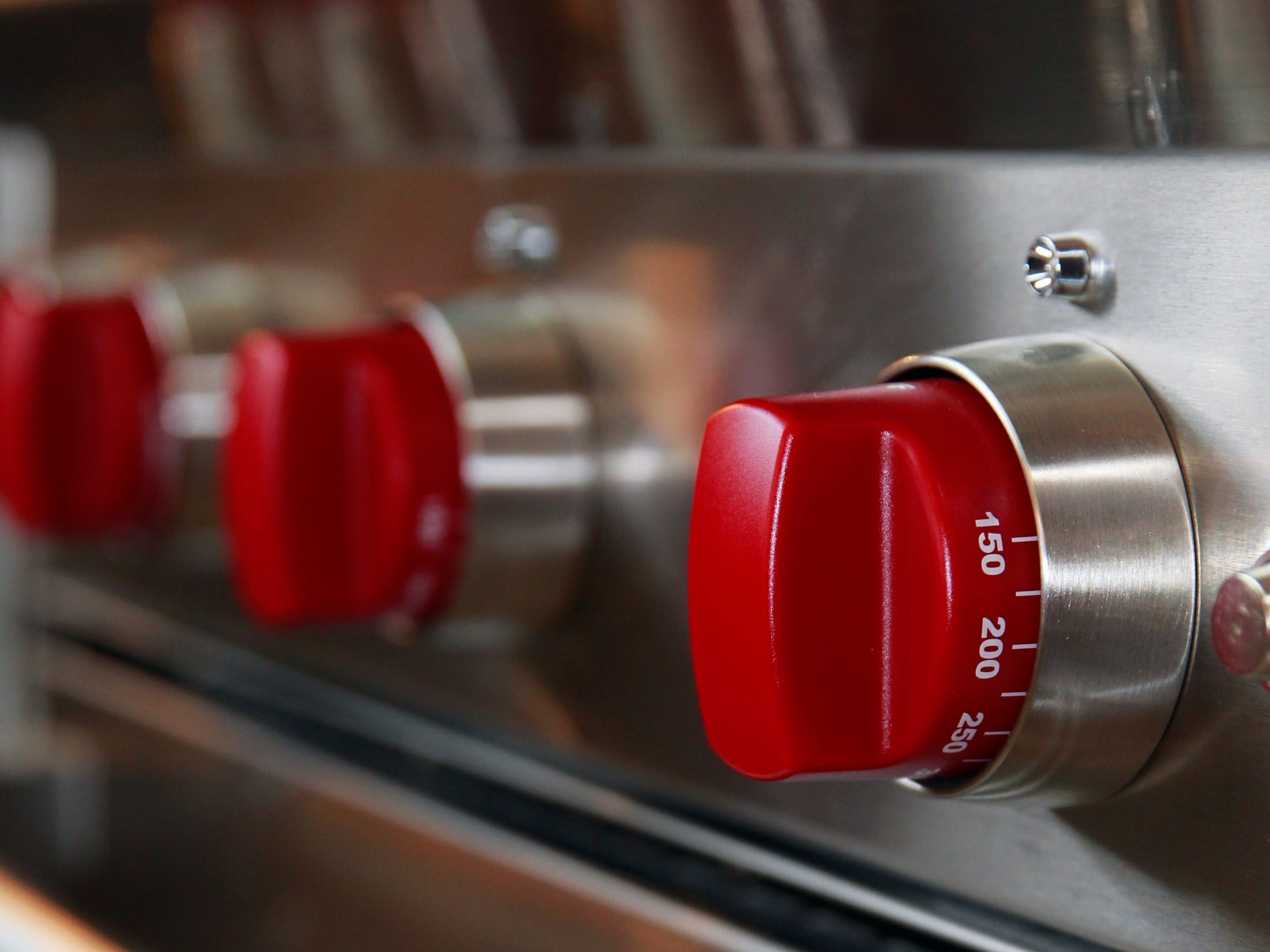 The red knobs on this Wolf stove add a splash of color to the kitchen. Red is Laura Goranson's favorite color.