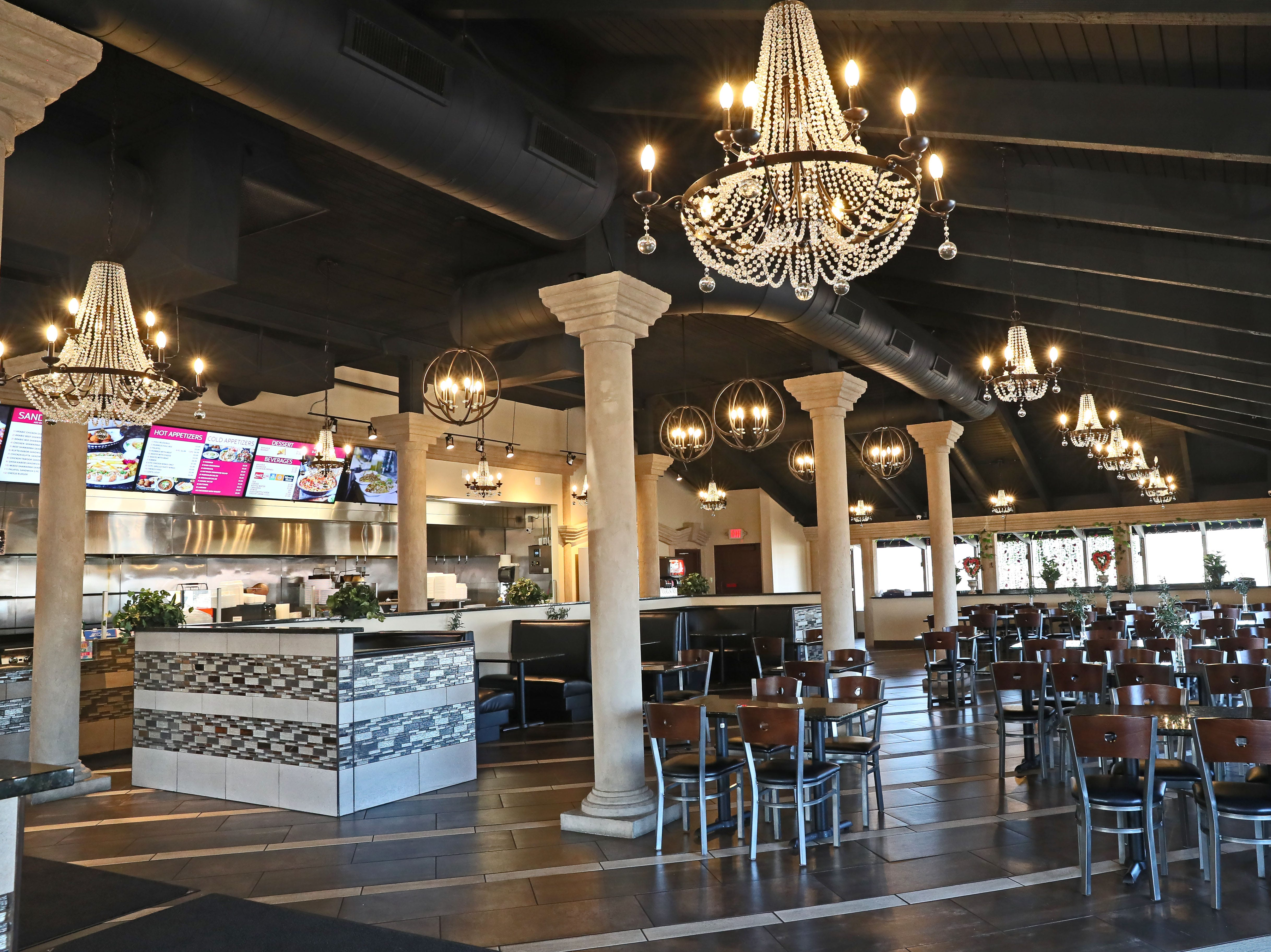The owners of Pita Palace completely remade the interior of 789 W. Layton Ave., adding chandeliers, decorative columns and granite for tabletops and counters.